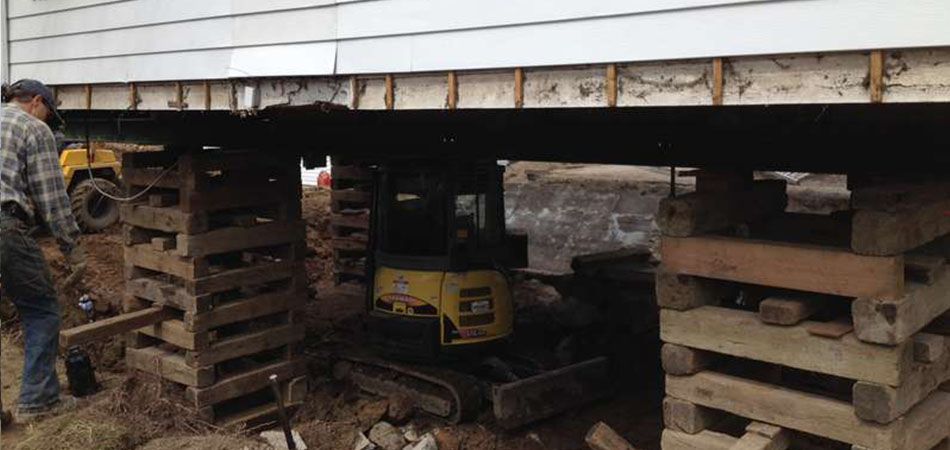 Soulèvement de maison et bâtiment pour décontamination - Levage de maison Robert Desjardins à Mirabel