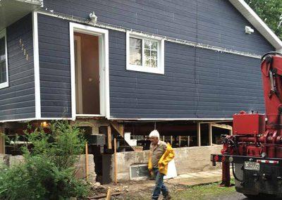 Étaiement de bâtiment et maison pour remplacement de fondation à Mirabel - Levage de maison Robert Desjardins à Mirabel
